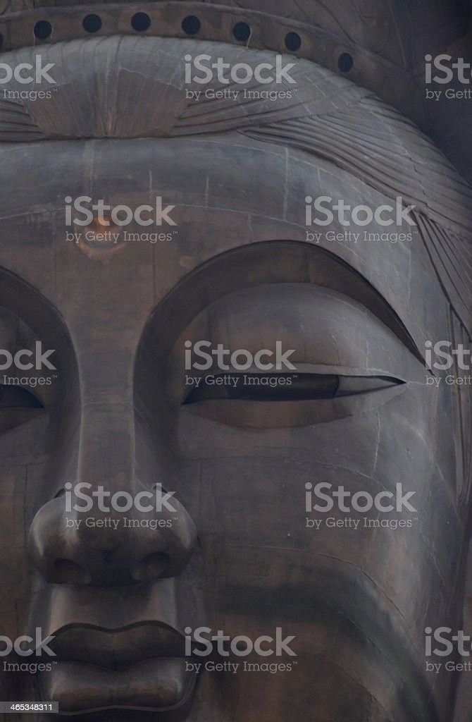 The closeup bronze face of merciful Guanyin royalty-free stock photo
