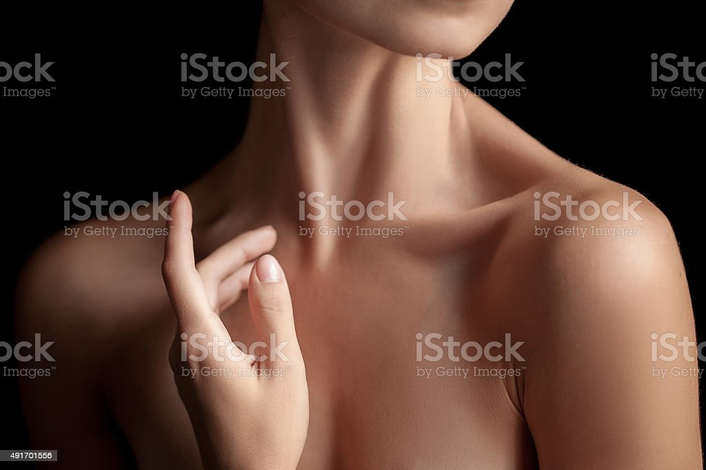 The close-up of a young woman's neck stock photo