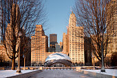 Chicago, USA - January 17, 2018: Cloud Gate is a public sculpture by Indian-born British artist Sir Anish Kapoor, that is the centerpiece of AT&T Plaza at Millennium Park in the Loop community area of Chicago, Illinois. The design was inspired by liquid mercury and the sculpture's surface reflects and distorts the city's skyline