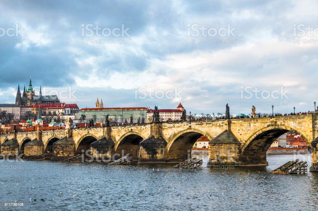 The clouds, bridge, river, castle stock photo