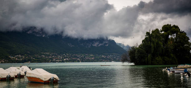 The clouds over lake Annecy France stock photo