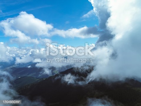 540203788 istock photo The cloudscape above the picturesque mountain landscape 1204930391