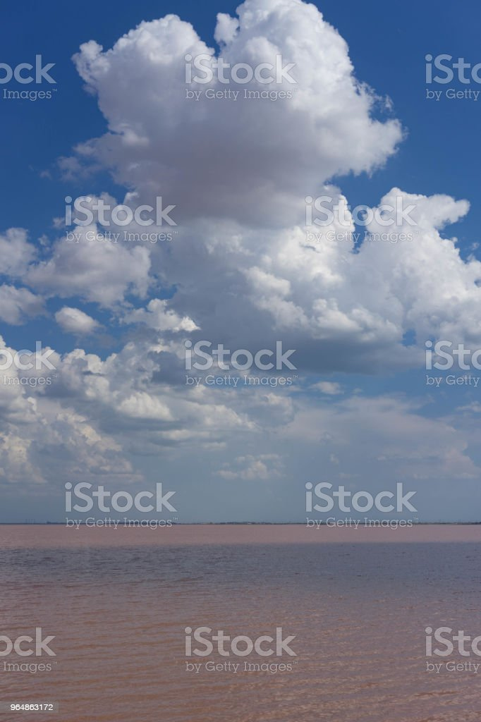 The cloudy sky over the pink lake. royalty-free stock photo