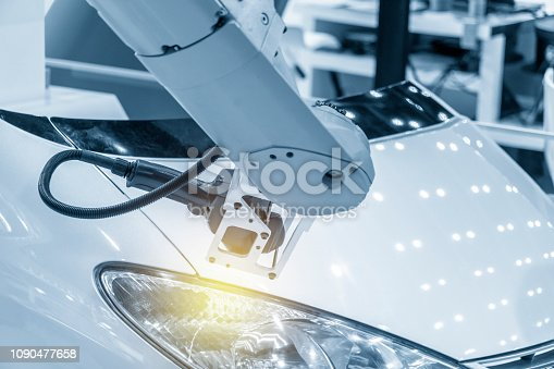 istock The  CMM laser probe  attach on the robotic arm. 1090477658