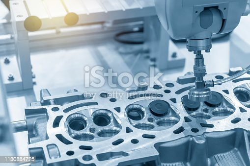istock The CNC bore machine boring the intake and exhaust valve port at cylinder head . 1130884725