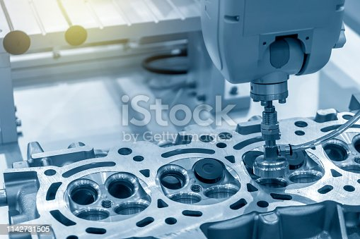 istock The CNC bore machine boring the intake and exhaust valve port at cylinder head . 1142731505
