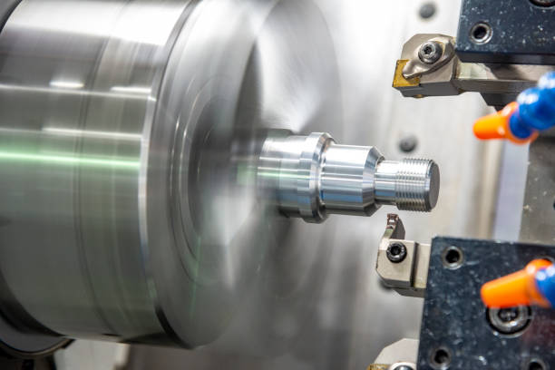 The CNC lathe  cutting the thread    at the metal parts. The CNC lathe  cutting the thread    at the metal parts. The hi-technology automotive parts manufacturing process by turning machine. threading stock pictures, royalty-free photos & images