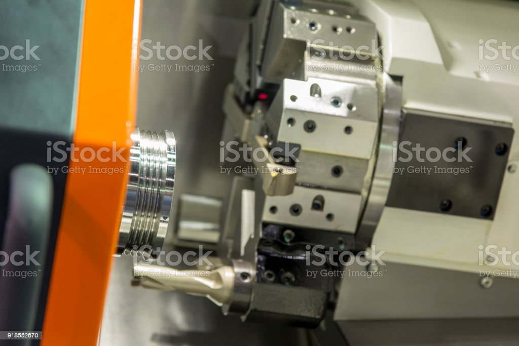 The  CNC lathe machine cutting the stainless thread part stock photo