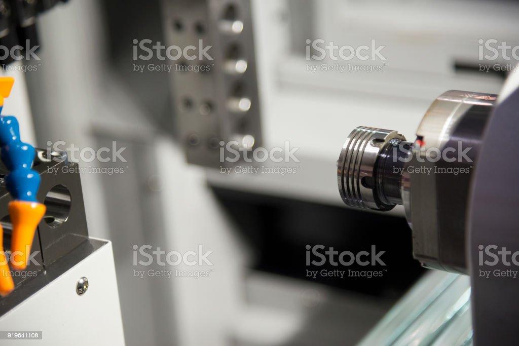 The CNC lathe machine cutting the thread stock photo
