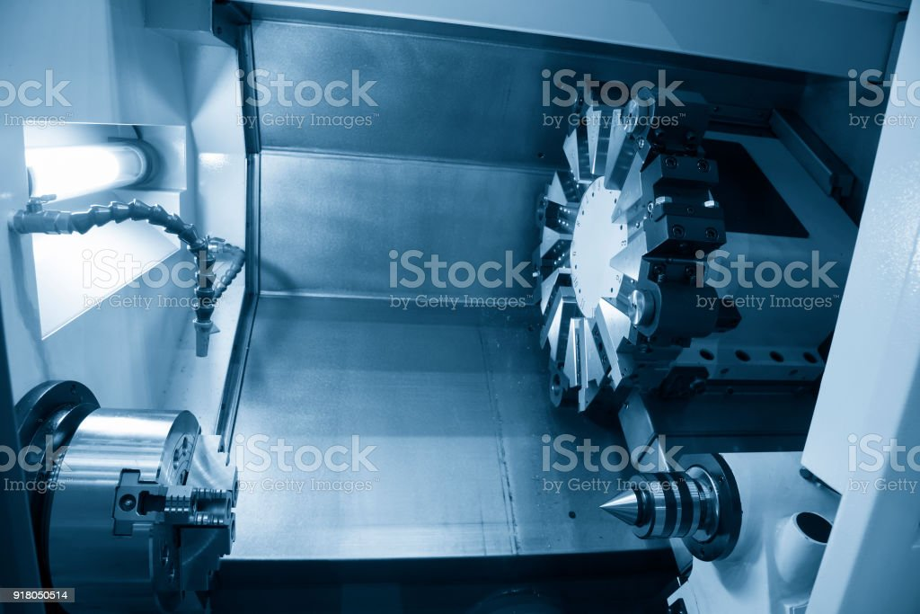 The  CNC lathe machine in the light blue scene. stock photo