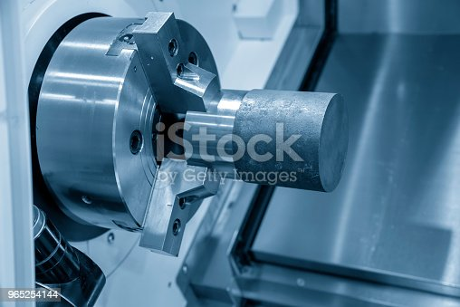 The Cnc Lathe Or Turing Machine Cutting The Raw Material In The Light Blue Scene Stock Photo & More Pictures of Accuracy
