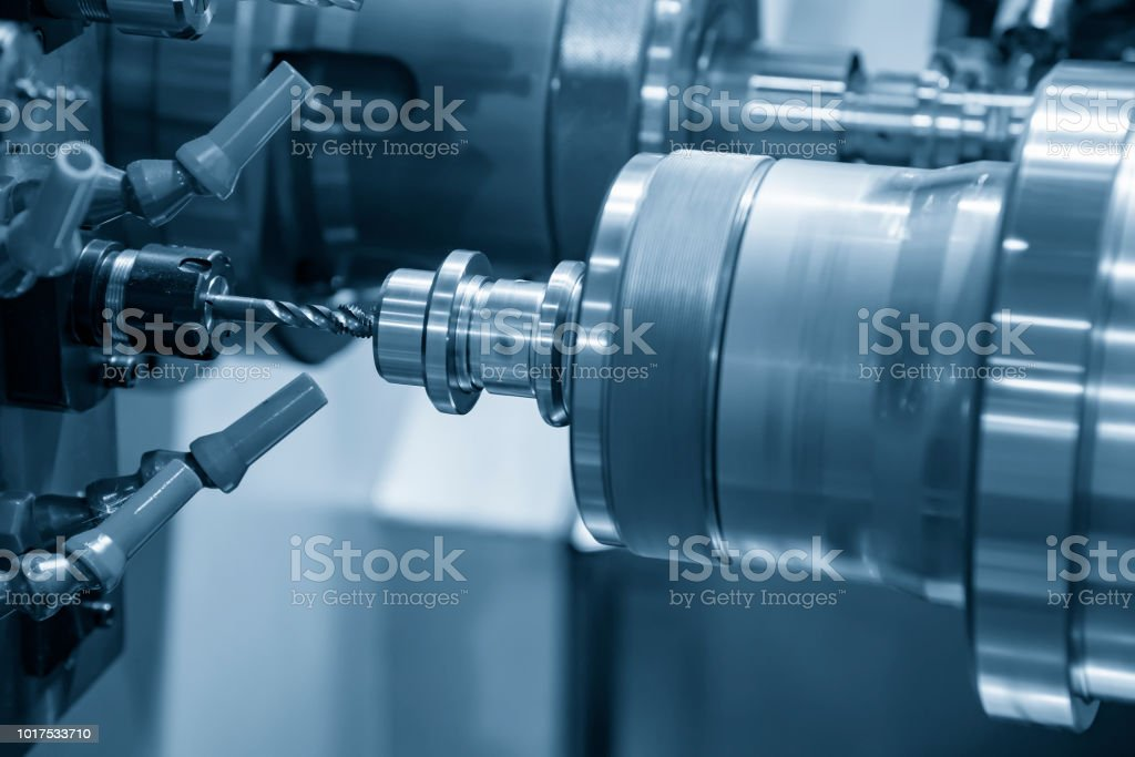 The CNC lathe or turning machine making the thread with the tapping...