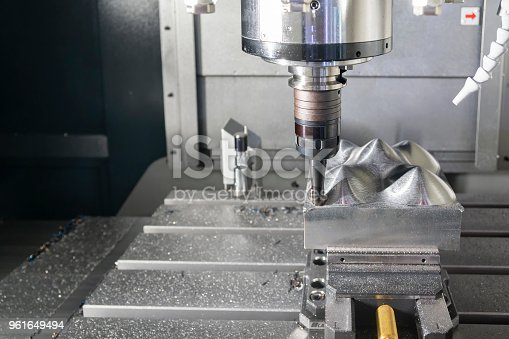istock The CNC milling machine cutting the metal mold part with the index-able  ball endmill  tool. 961649494