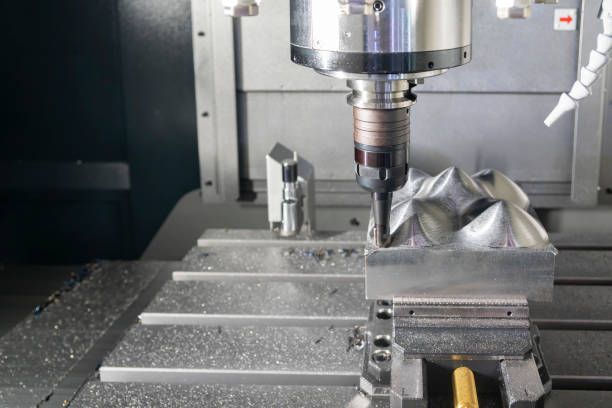 The CNC milling machine cutting the metal mold part with the index-able  ball endmill  tool. The CNC milling machine cutting the metal mold part with the index-able  ball endmill  tool. High technology mold manufacturing process. metalwork stock pictures, royalty-free photos & images