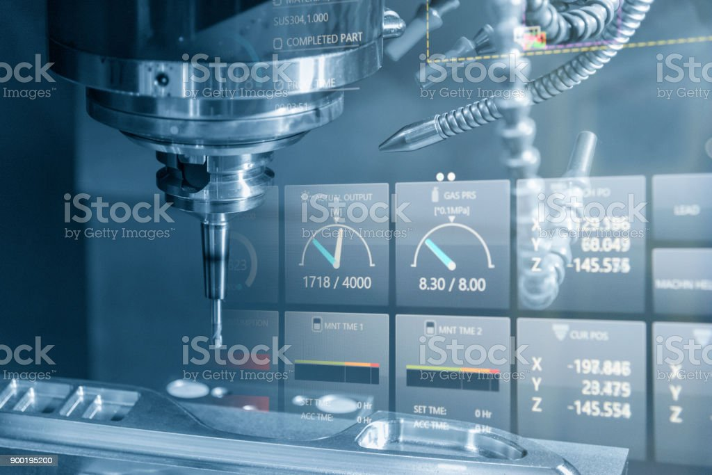 The CNC milling machine cutting the sample part. stock photo