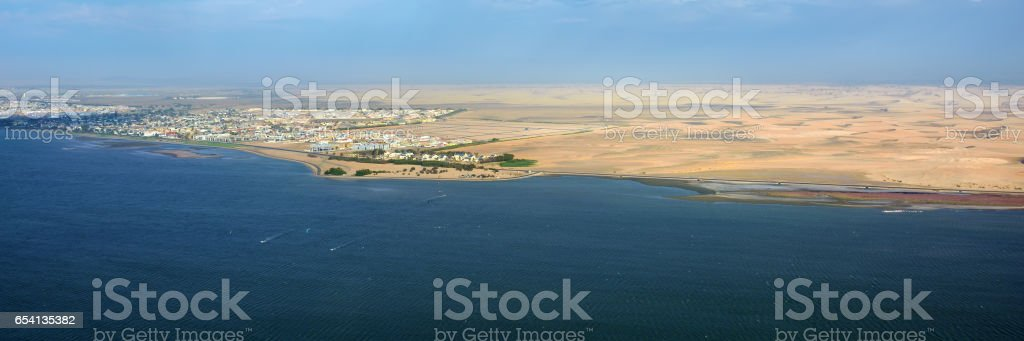 The coast in Namibia and panorama of the city Walvis Bay i stock photo