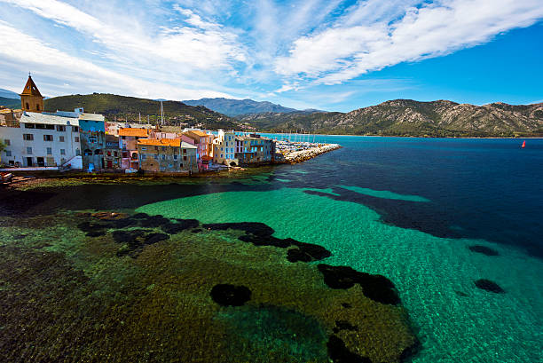 The coast of Saint Florent Bay in Corsica Coastline of Saint Florent Bay in Corsica Island, the old part of Saint-Florent city is in the middle, Haute Corse, France religious saint stock pictures, royalty-free photos & images