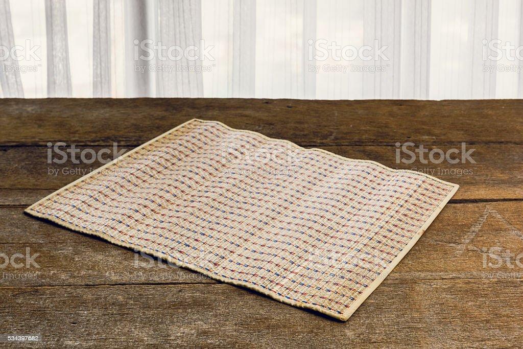 The Coaster, Dark brown bamboo mat stock photo