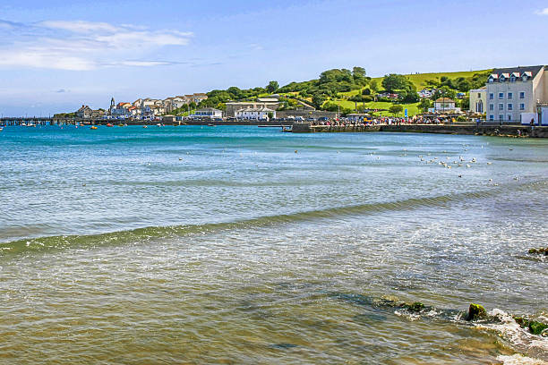 The coastline of Dorset and the bay at Swanage , UK The coastline of Dorset and the bay at Swanage , UK esplanade theater stock pictures, royalty-free photos & images