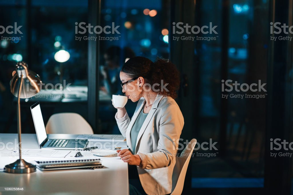 The coffee gets her going stock photo