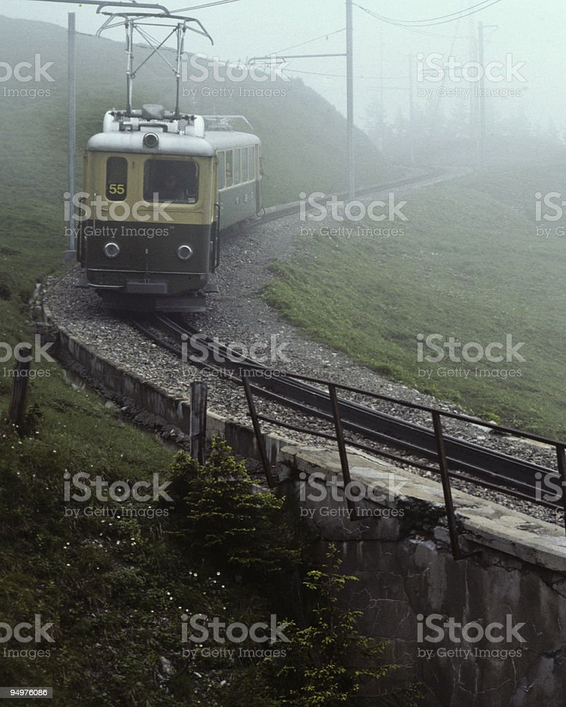 Cog-Wheel Train Coming Through the Fog royalty-free stock photo