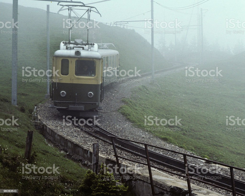 Cog-Wheel Train Approaching Through the Fog royalty-free stock photo