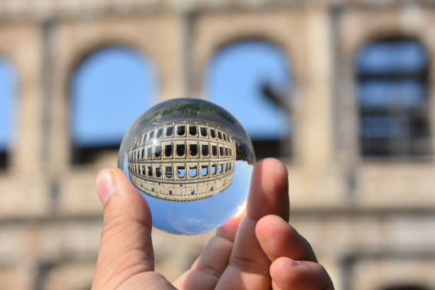 the Coliseum in Rome  through a crystal ball stock photo