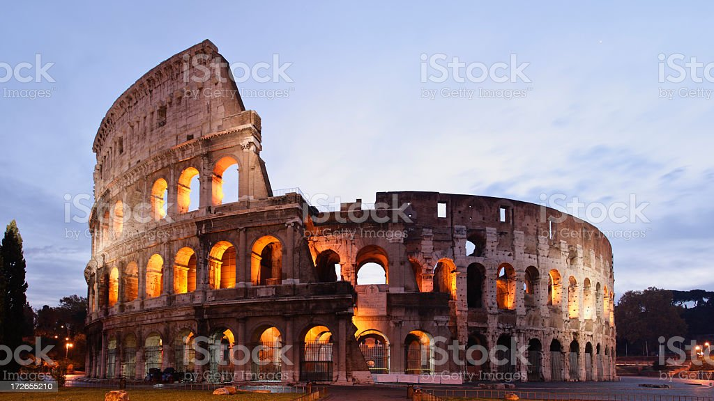 The Coliseum with arches illuminated during the evening royalty-free stock photo