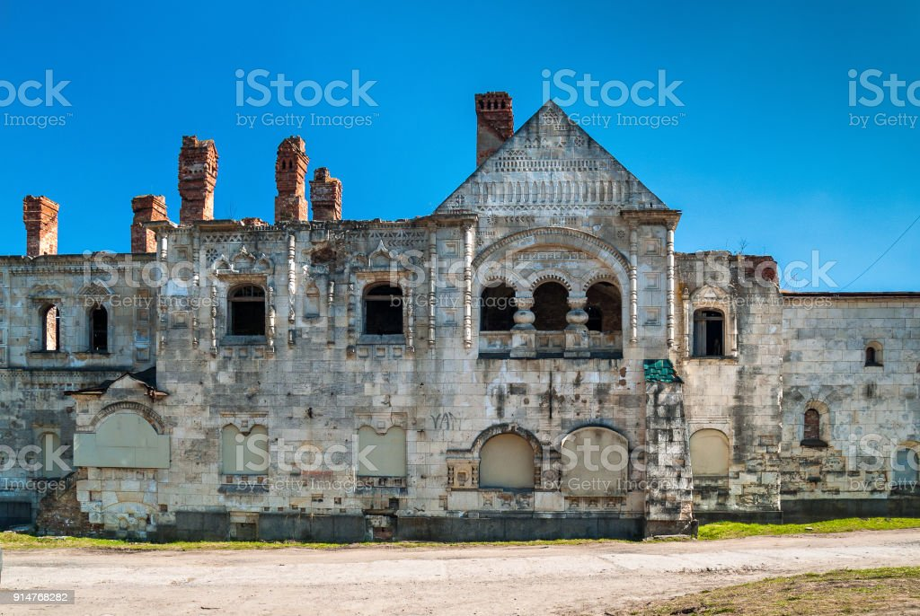 The collapsed facade of the architectural complex Fedorovsky town in Tsarskoye Selo in the Alexandrolsky park in St. Petersburg stock photo