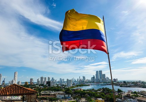 istock The Colombian flag on a beautiful blue sky 1141130458