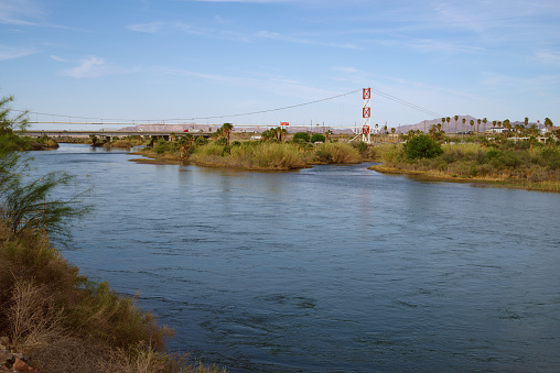 Image of the Colorado River at the California-Arizona border. The interstate highway 10 is in the background.