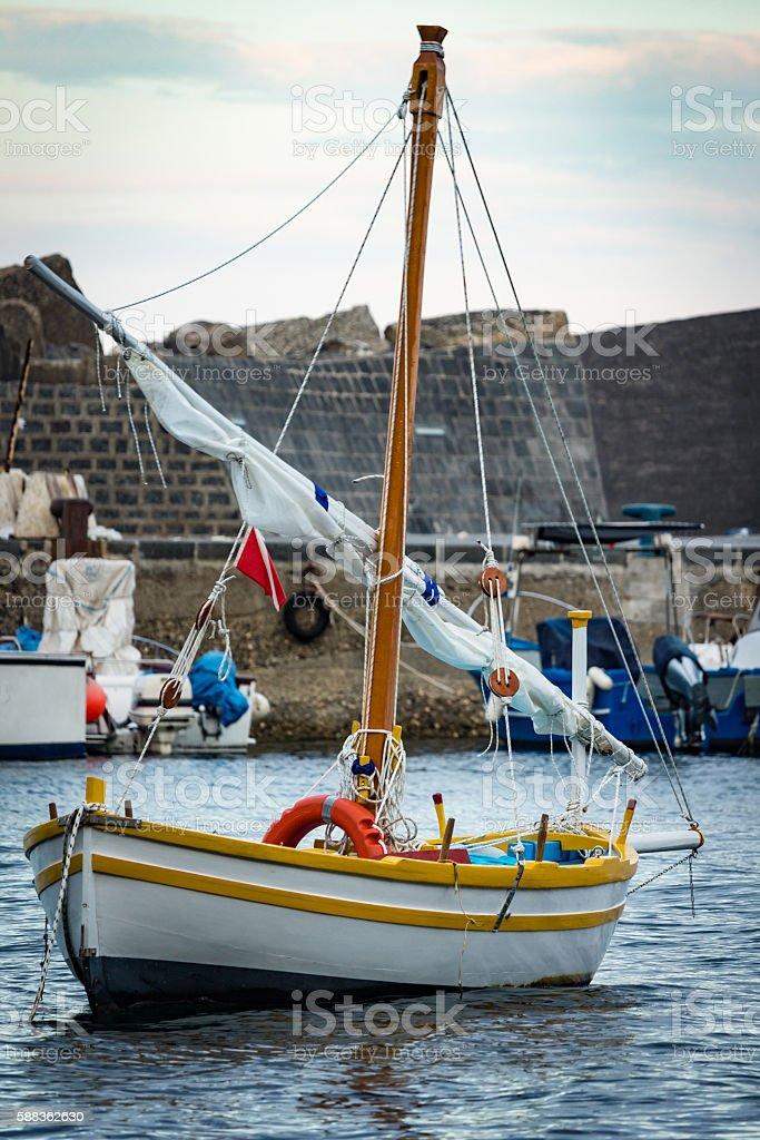 the colored sailboat - foto stock