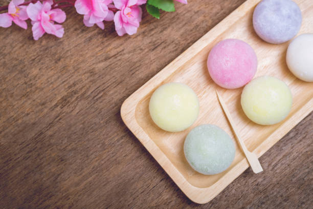 The colorful mochi dessert ice cream on wood plate ,Close Up photo with selective focus. stock photo