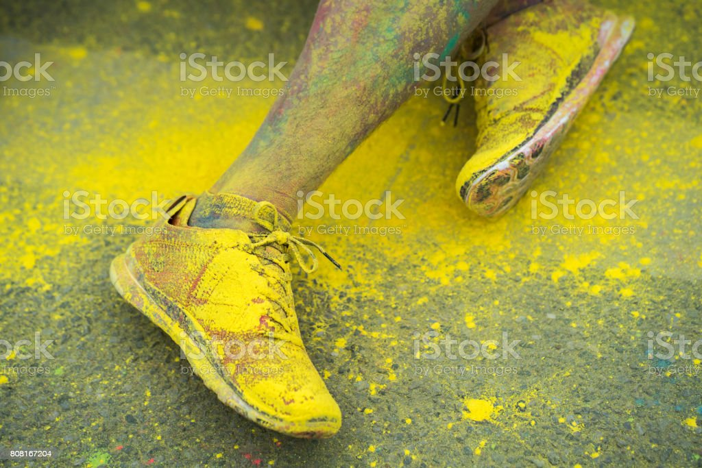 The colorful shoes and legs of teenagers at color run event stock photo