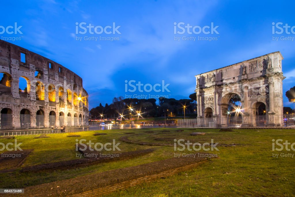 The Colosseum and The Arch of Titus in Rome stock photo