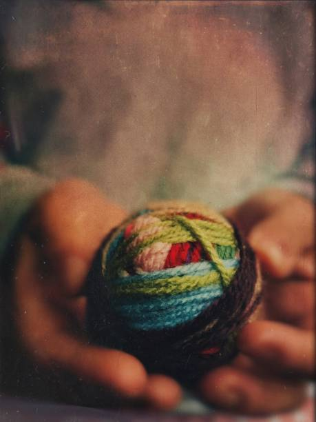 The colourful skein in the hands