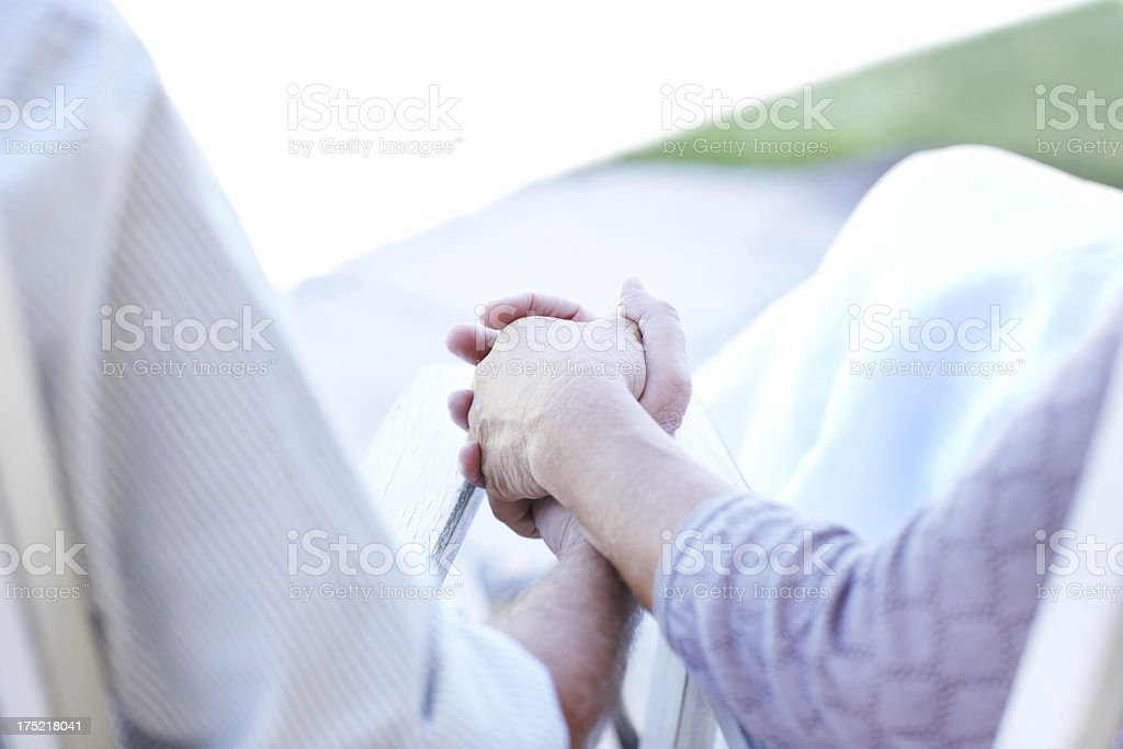 The comfort of your hand in mine royalty-free stock photo