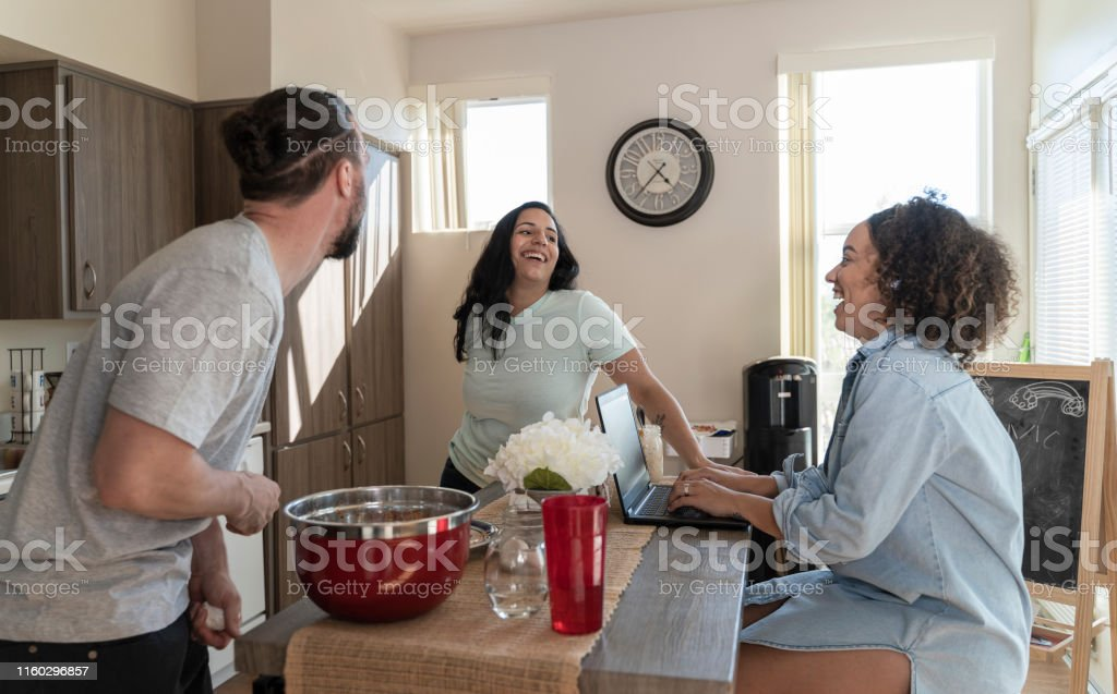 The group of millennials of different ethnicity, roommates, in their...