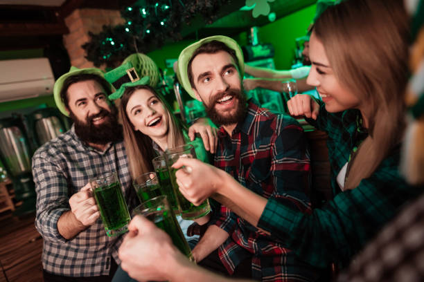 the company of young people celebrate st. patrick's day. - st patricks days stock photos and pictures
