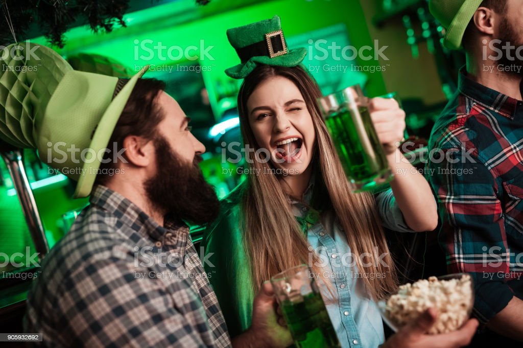 The company of young people celebrate St. Patrick's Day. stock photo