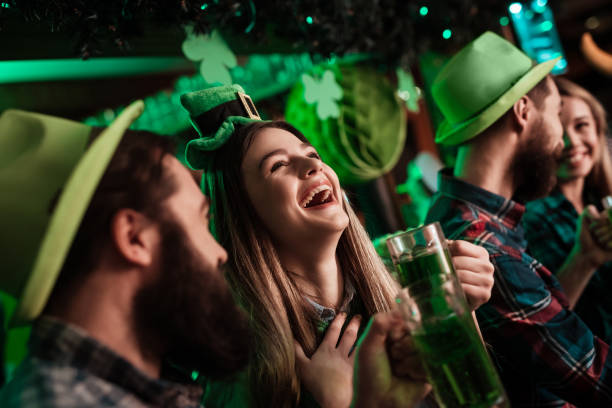 the company of young people celebrate st. patrick's day. - st patricks day food stock photos and pictures