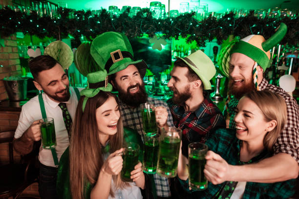the company of young people celebrate st. patrick's day. - st patricks day stock photos and pictures