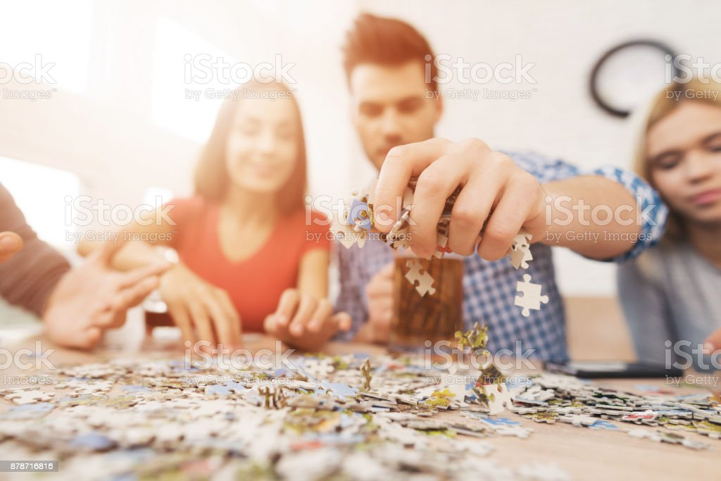 The company of young people is folding the image. stock photo