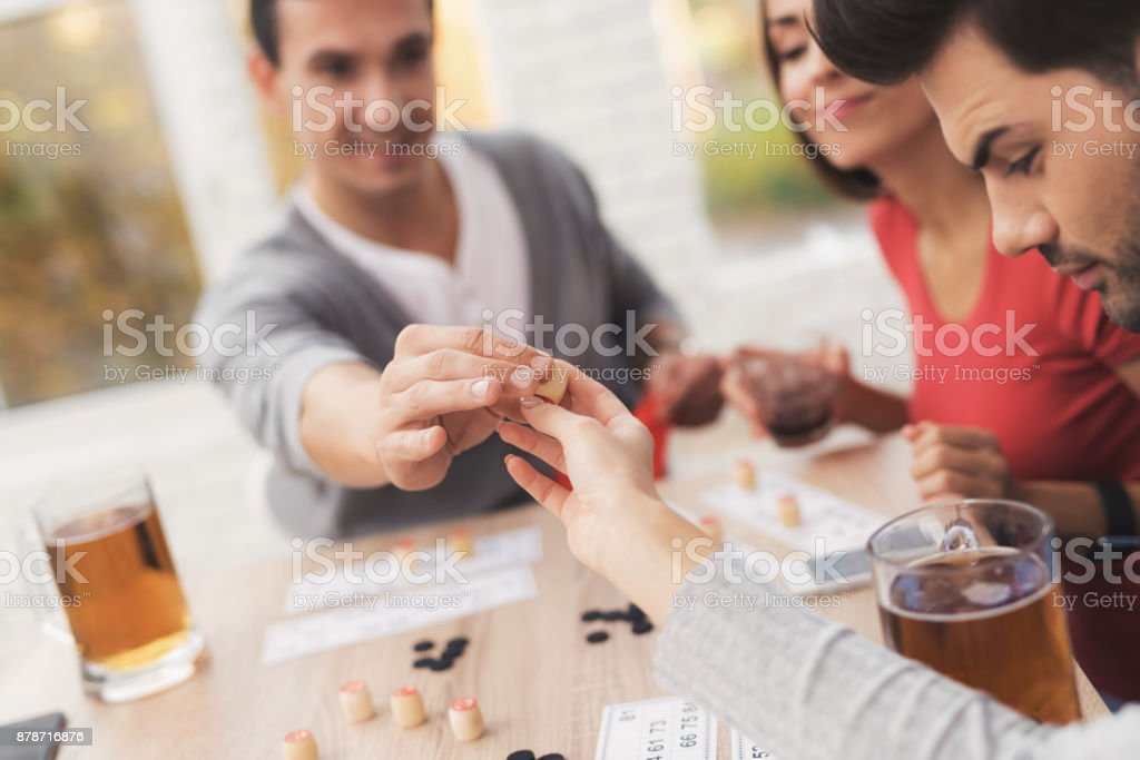 The company of young people is playing in russian lotto. stock photo