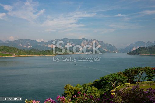 The complex mountains are in the lake with the sky and water in the beautiful lake
