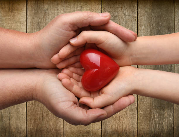 the concept i love you child and parent - organ donation stock pictures, royalty-free photos & images