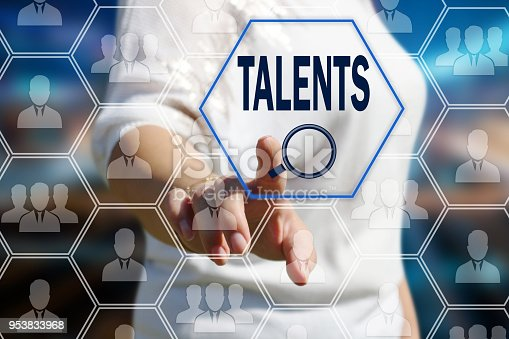 641422198istockphoto The concept is the search for talented personnel, HR . The businessman pulled the search for qualified specialists in the field of the newest technologies on the touch screen with a futuristic background. 953833968