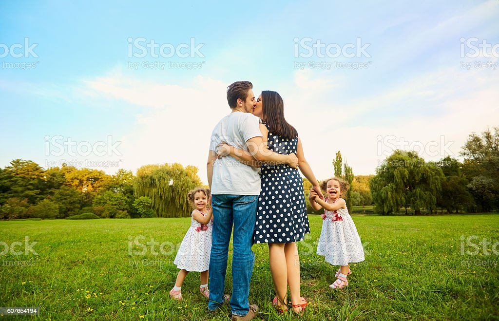 The concept of a happy family. Parents with children walk stock photo