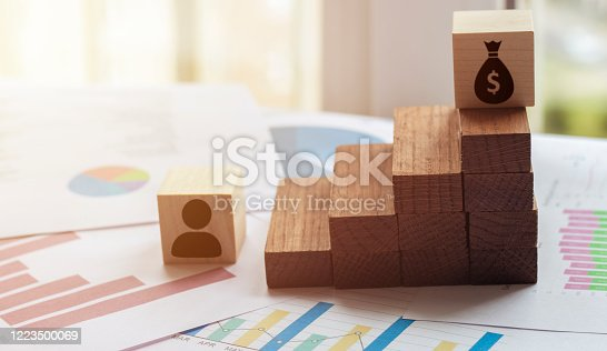 The concept of a successful and growing business is a staircase made of wooden blocks. Close up.