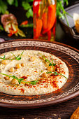 istock The concept of Arabic cuisine. Oriental hummus with grilled sesame and pistachios. Laid arabic table for the holiday. Background image. Top view, copy space 1130952591